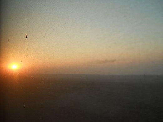 sunrise over th bleak desert