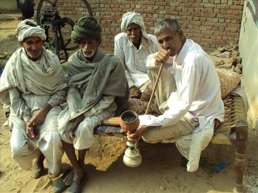 Chilling out in the afternoon - one of the leisure activities of the men living in the villages is gathering and smoking using a special tool (pipe) called chillum