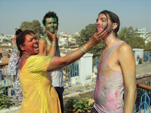 Holi (the festival of colors) - no matter where or how you live, celebrations are for everybody :). Here is Mama ji - the owner of a guesthouse celebrating Holi with two of her guests from Brazil.