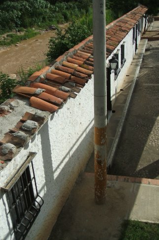 the wall between the river and the town is a facade of houses