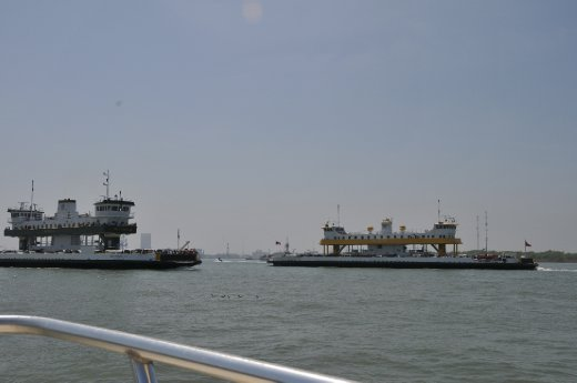 Ferries passing each other and us