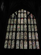 Winchester Cathedral inside. This window was broken in the uprising and villagers came and swept up all the stained glass and hid it. Years later it has been reassembled as a mosaic: by nomad_kiwis, Views[373]