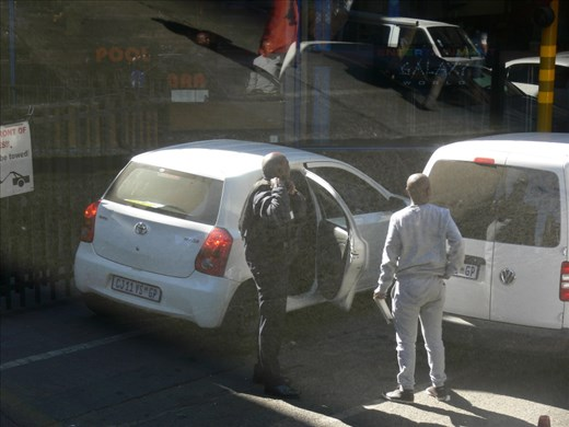 Securtiy guard putting on a bullet proof jacket before going to work