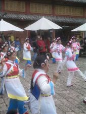 Yunan traditional dancing in a Lijiang street: by nomadnorrie, Views[237]