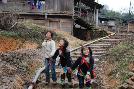 Three of the kids following me around all the village