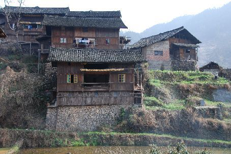 Xijiang village style house with the hole in the middle.