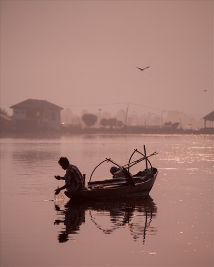 A Fishermen on the Dhal Lake, waiting for his early morning catch.