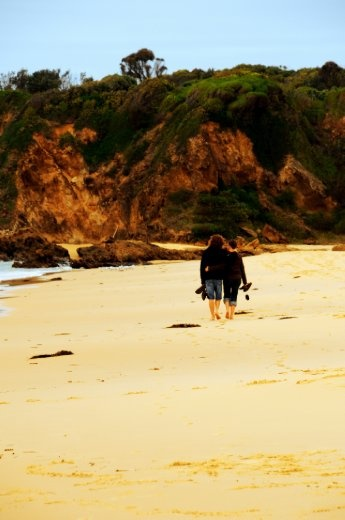 this image makes me think of a new couple in love. the way they hold eachother as they walk barefoot along the sand like nothing else matters, like all that is important is that in this moment they have a hold of eachother.