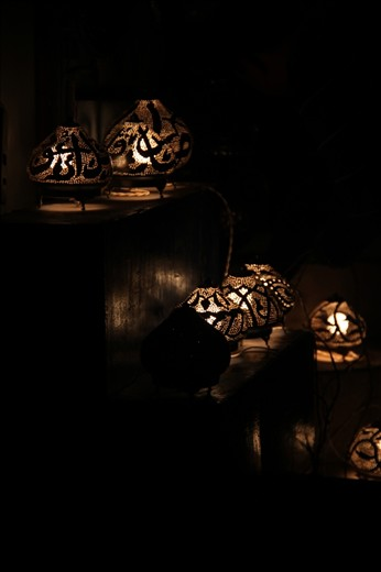 decorated light bulbs, traditionally made from cupper shaped as Arabic letters.
