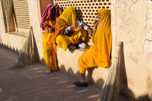 Women taking a break from thoroughly sweeping the interior of the Amer Palace in Jaipur.