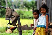 'home' - taken in the rural town of Kampot, South Cambodia. I was once again on my bike, cycling through the rice fields and noticed a brother and sister playing in front of their home. The moment captures their curiosity in me as much as them, in the setting of a normal day at home.: by oneglassglobe, Views[581]