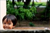 'pure smile' - taken in the rural town of Kampot, South Cambodia. A moment captured in the front yard of my home at the time. A curious, cheeky little boy peeking over the fence with an ear to ear smile. : by oneglassglobe, Views[305]