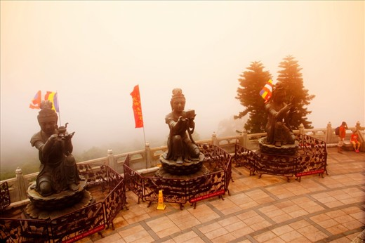 Not just the Buddha is the only attraction, here a series of religious statues outline the view as it is overcome with mist