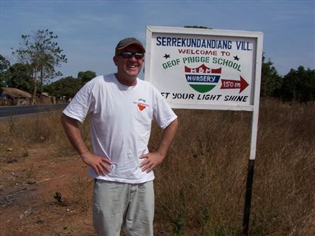 Founder Geof Prigge at school sign