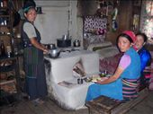 Cosy kitchen of our lodge at Rimche. Do you like the stove? It's made from rocks and clay. The ladies are Tamang, from Tibetan heritage.: by over-40, Views[887]