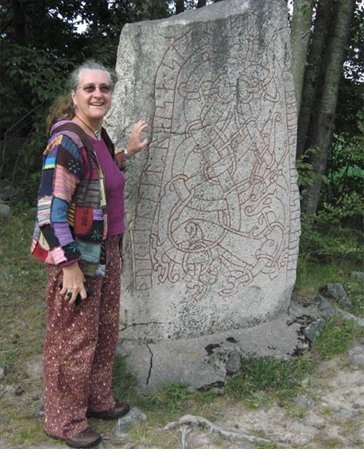 Standing by a Rune stone, erected by a woman in memory of her son, c.1100