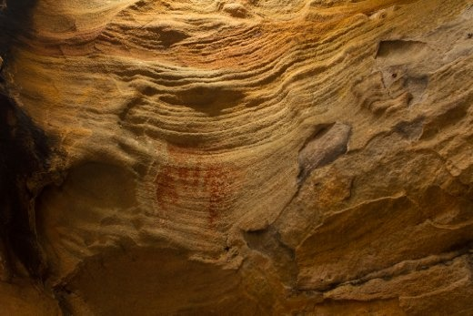 A resident of the park left their stencilled hand print on the sandstone of a cave wall over 2000 years ago in red ochre.