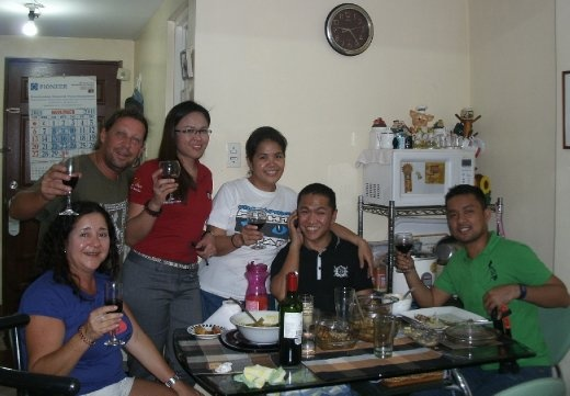 Enjoying some wine and a great chat with our new Filipino friends ...