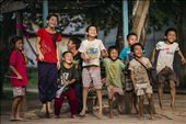 Innocent Village kids from the Golden Triangle Region bordering Laos, Bhurma, and Thailand.   The kids benefit from the tourism, while illicit drug trade is happening unseemly all around the them. : by pck888, Views[574]