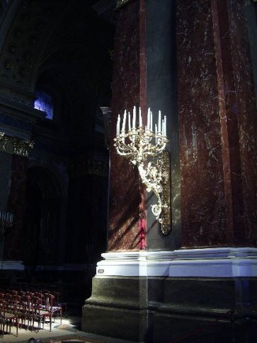 Gold candlestick in St Stephen's Basilica, Budapest. Lit a candle.