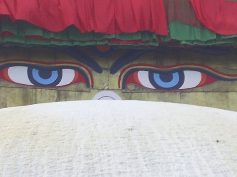 the eyes at the top of the stupa