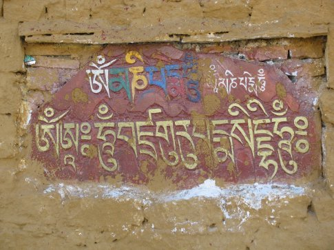 inscriptions and paintings on the outside wall