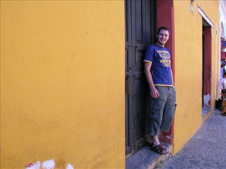 Pete in Antigua. The houses are colourful here