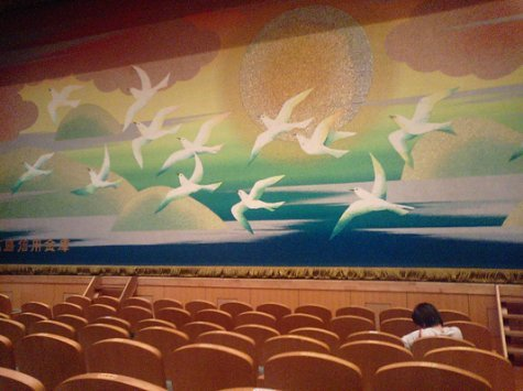 In the 'medium' hall, the curtain covering the screen is embroidered