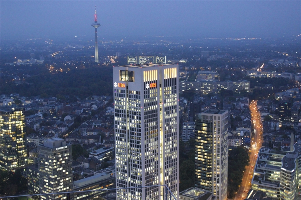 The modern side of Germany shown through a newer skyscraper Opernturm, Frankfurt. The small details play the role here, the television tower showing the development since 1970s and empty road in comparison with full offices suggest a hard-work of Germans on Monday evening.