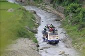 This is photo of a bus overloaded and its rainy season the way turned into rive rbut nothing stops.: by photo-nature, Views[113]