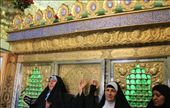 Iran - Qom - ladies visiting a mausoleum and having their photo taken in front of the zarih