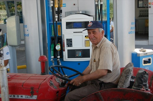 Farmer filling tractor at service station