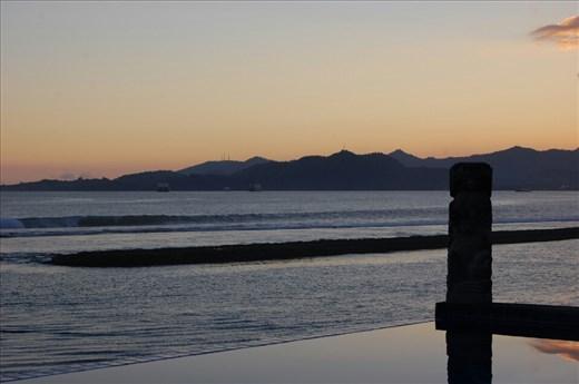 Sunset  from pool in Bayshore Villas Candi Dasa