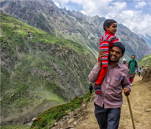 A Pilgrim and his child during the track of Amarnath .