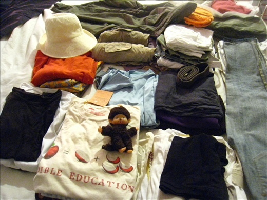 All the clothing (plus three pairs of shoes) I packed for the entire trip, learning to pack lightly and live simply!