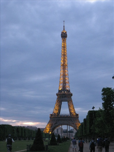 Eiffel Tower at sunset, starting to light up.