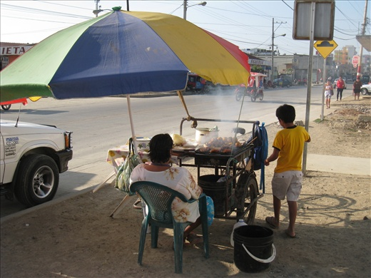 Many food vendors along the streets in Puerto Lopez, almost all fried or roasted food.