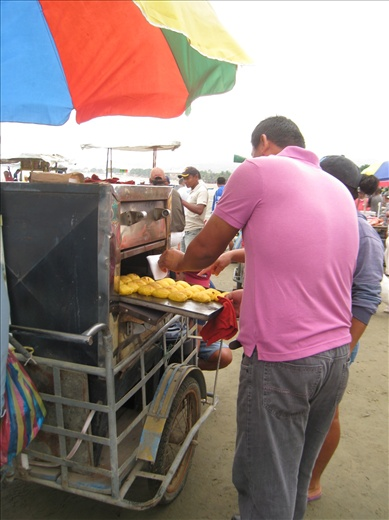 One of many food vendors at the fish market, he has an oven hooked to a propane tank, so the bread stays warm. hope to try one!