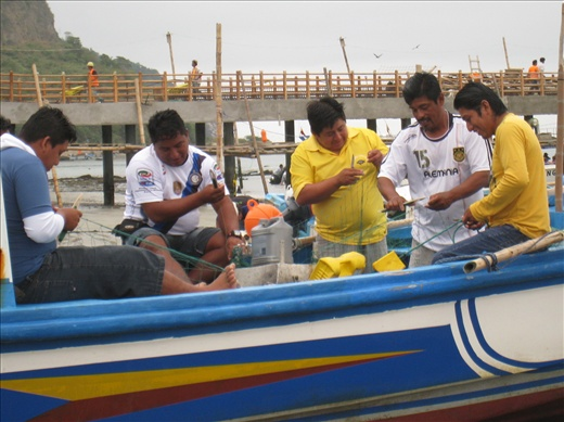 When not fishing, fishermen work on their nets, mending and maintaining. Fishing is no easy career.