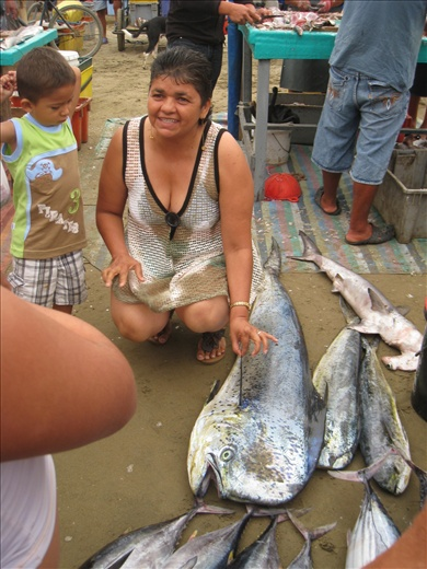 A huge el dorado at the fish market one morning, the mother wanted the kid to pose next to it but he was scared, so she got into the photo also. funny how parents make kids do stuff like that!