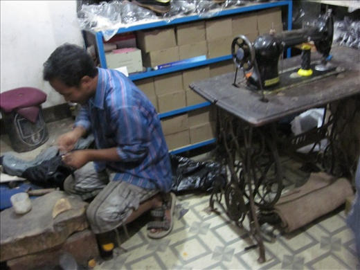 Shoe repair man in action