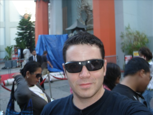 in front of chinese cinema, looking cool