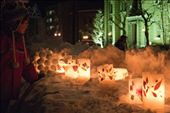 Enchanted:  A young girl is captivated by the flame of the candles along one stretch of the path.  Displays range from candles decorated with delicate leaves and flowers to simple stacks of snowballs surrounding a few votive candles for effect.  : by portlandvagabond, Views[1042]