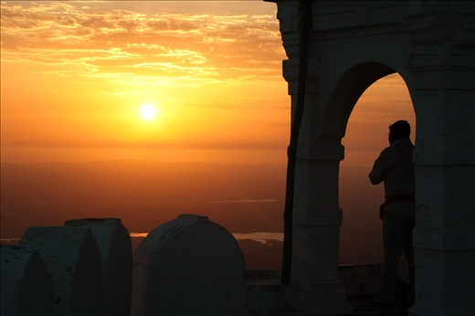 A priest says 'hello' to the newly risen sun