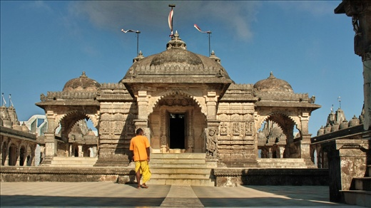 A priest walks up to one of the many temples