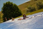 """(2) Even though there are over 60,000 residents, Missoula retains a """"small-town"""" feel. The pace of life can be as fast or as slow as one chooses it to be.  Neighborhood children shown above slip-and-slide down a hill during a community barbeque open to all.  Here, there is no right or wrong way to enjoy oneself.: by prhutchi, Views[383]"""