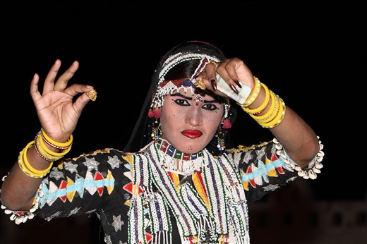 A folk dancer performing in Khuri village on the desert of Jaisailmer,Rajasthan.