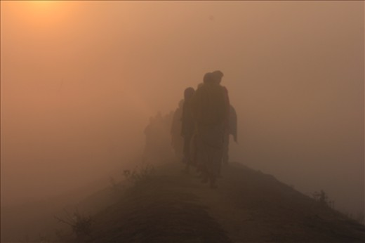 Villagers returning to their home in the morning to get back in their daily life