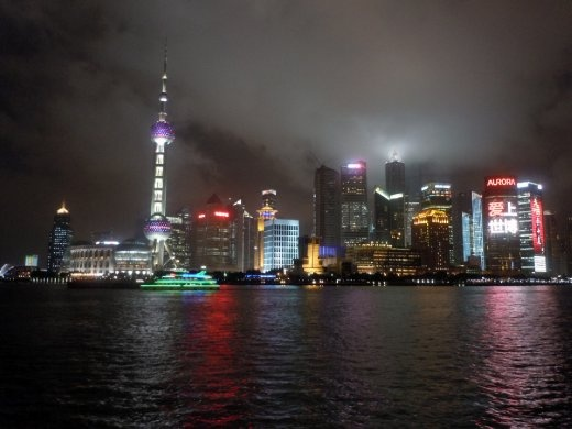 The pudong view in China is amazing, specially at night. In this photo we can see why the city is called Shanghai, upon the sea. But now is not longer a fisher village but the must modern city in China. Nikon Coolpix. Shanghai, China.