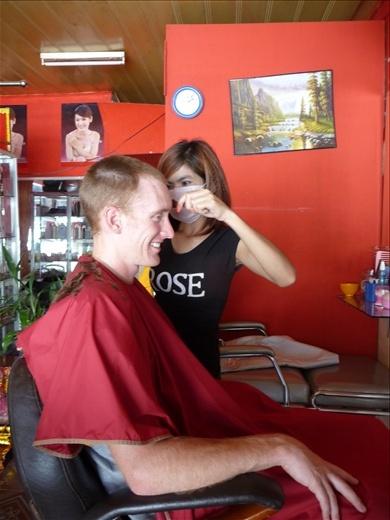 Travis getting his hair cut